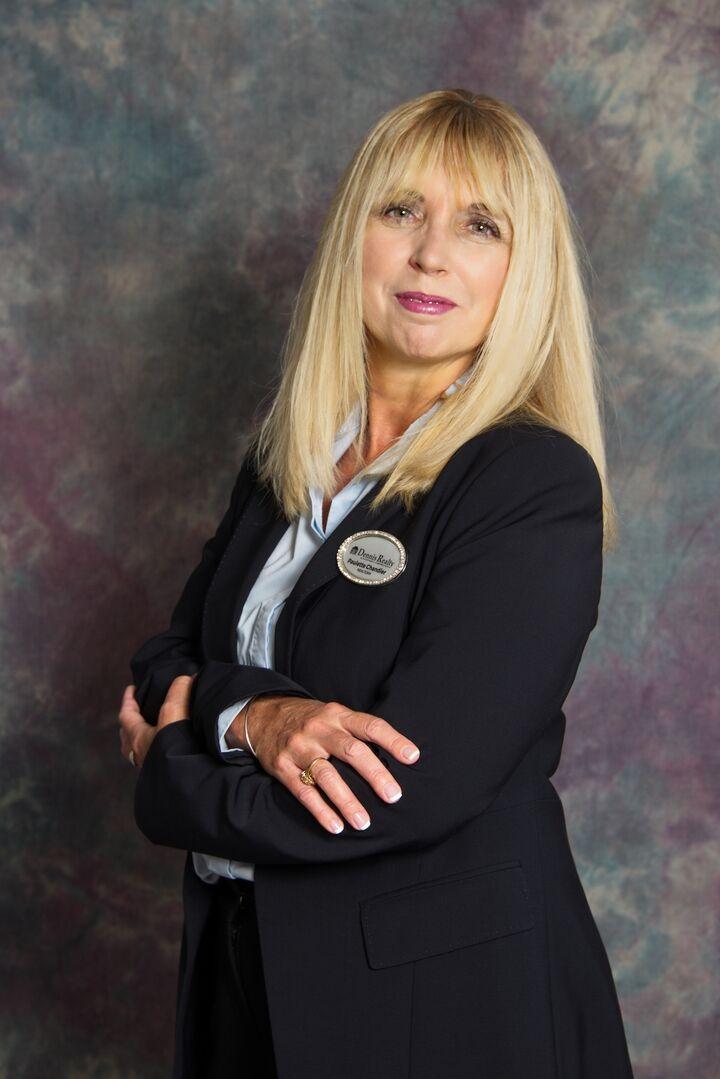 Paulette Chandler,  in Hernando Beach, Dennis Realty & Investment Corp.